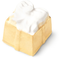 A gift shaped golden bath bomb with a white bow design on top