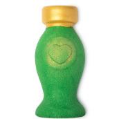 grünes flaschenförmiges schaumbad mit goldener deko