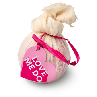 pink bath bomb wrapped in muslin