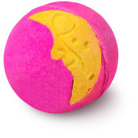 pink bath bomb with yellow moon shape on it