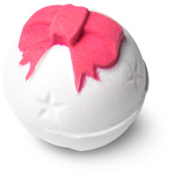 white bath bomb with pink ribbon pattern on top