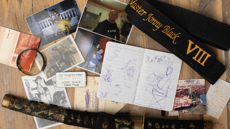 A collection of photographs and old belongings of Taya's father, Jonny Black.