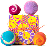 multicoloured gift box with smiley face on it surrounded by products