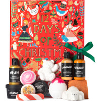 red christmas themed gift box with products around it