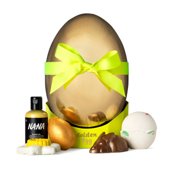golden egg shaped gift box with products around it