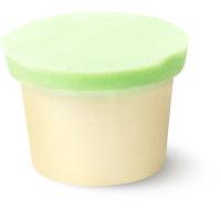 una hidratante corporal sólida sin envases de color verde y blanco