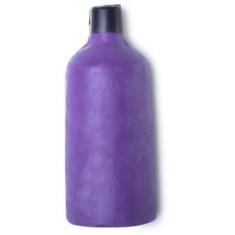 Gel doccia nudo a forma di bottiglia di colore viola con tappo di nero di cera.