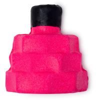pinkes schaumbad in der form einer quadratischen parfümflasche