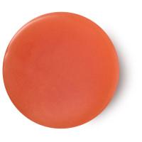 Karma perfume sólido vegano de color naranja que combina naranja, especias y pachuli perfume para llevar de viaje