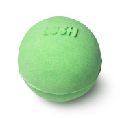 A green, spherical bath bomb with the word LUSH embossed on top