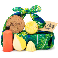 green leaf themed knot wrap present surrounded by products