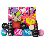 purple pink green and yellow gift box with products around it
