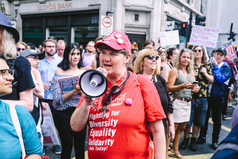 Trump demo - woman with megaphone