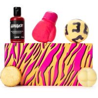A retangular leopard skin orange and pink box with bath and shower cosmetics around it