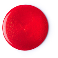 circular blob of red shower gel with golden shimmer