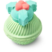 green bath bomb with holly shaped cap