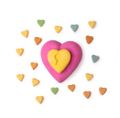 love locket bath bomb surrounded by the little heart bath bombs it is filled with.