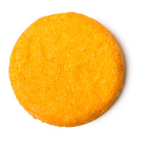 Ein rundes, festes orangefarbenes Shampoo