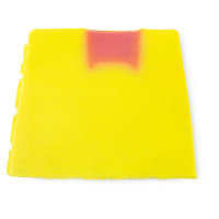 A block of the yellow and orange Rhubarb and Custard Soap