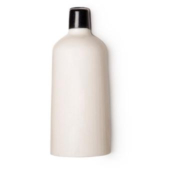 Uma garrafa branca de gel de duche sólido