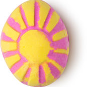 A pink bath bomb in the shape of a egg with yellow stripes