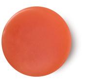 Karma perfume sólido vegano de color naranja que combina naranja, especias y pachuli