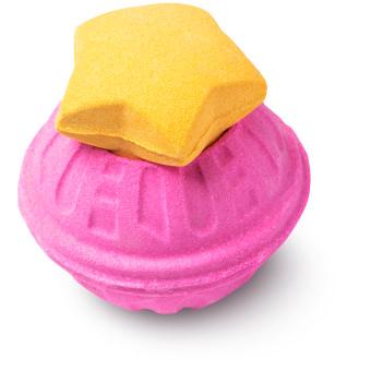 pink bath bomb with orange star shaped cap