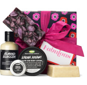 a fabulous gift set with pink ribbon and handmade products surrounding gift