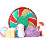 circular tin with christmas pattern on it and products around it