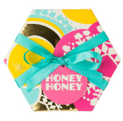 hexagonal pink yellow and black gift with blue tie