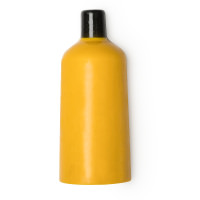 Uma garrafa amarela de gel duche sólido