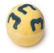 yellow bath bomb with dark grey blue m shape pattern