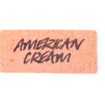 A peach coloured washcard featuring the words American Cream