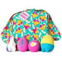 gift bag with bunny ears and products around it