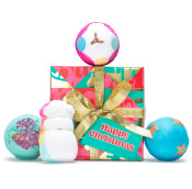 pink and green gold ribboned gift with blue and white bath bombs