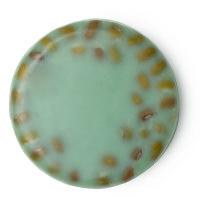 Ein grüner, kreisrunder Reiniger mit schwarzen Mungobohnen auf der Oberseite