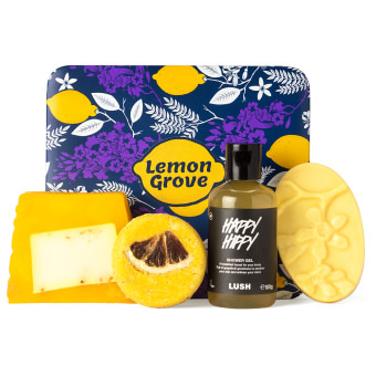 purple lemon themed gift box with products around it