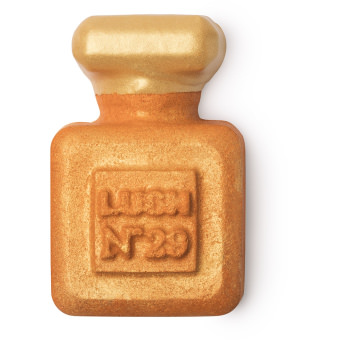 golden coloured perfume scented bottle shaped bubble bar