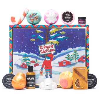A square gift box with products surrounding - 12 Days Of Christmas