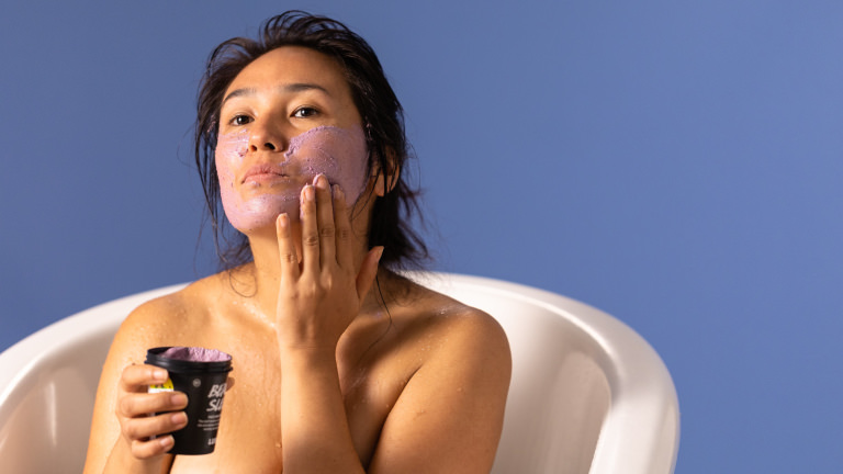 A person is applying beauty sleep face mask to their cheek