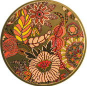 gold red and yellow patterned circular tin