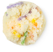 cream coloured circle of lip scrub with multicoloured sprinkles in it