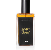 A bottle of Dear John Lush perfume. The perfume deep orange in colour and contained in a rectangle bottle featuring a black lid and label.