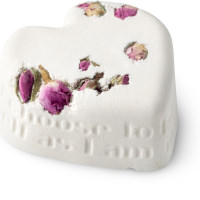 a white heart shaped bath bomb with petals