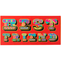 red present with best friend written on it in multicoloured pattern