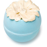 A blue bath bomb topped with a flower