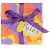 A lilac, orange and yellow gift box with a purple ribbon as seen from the front