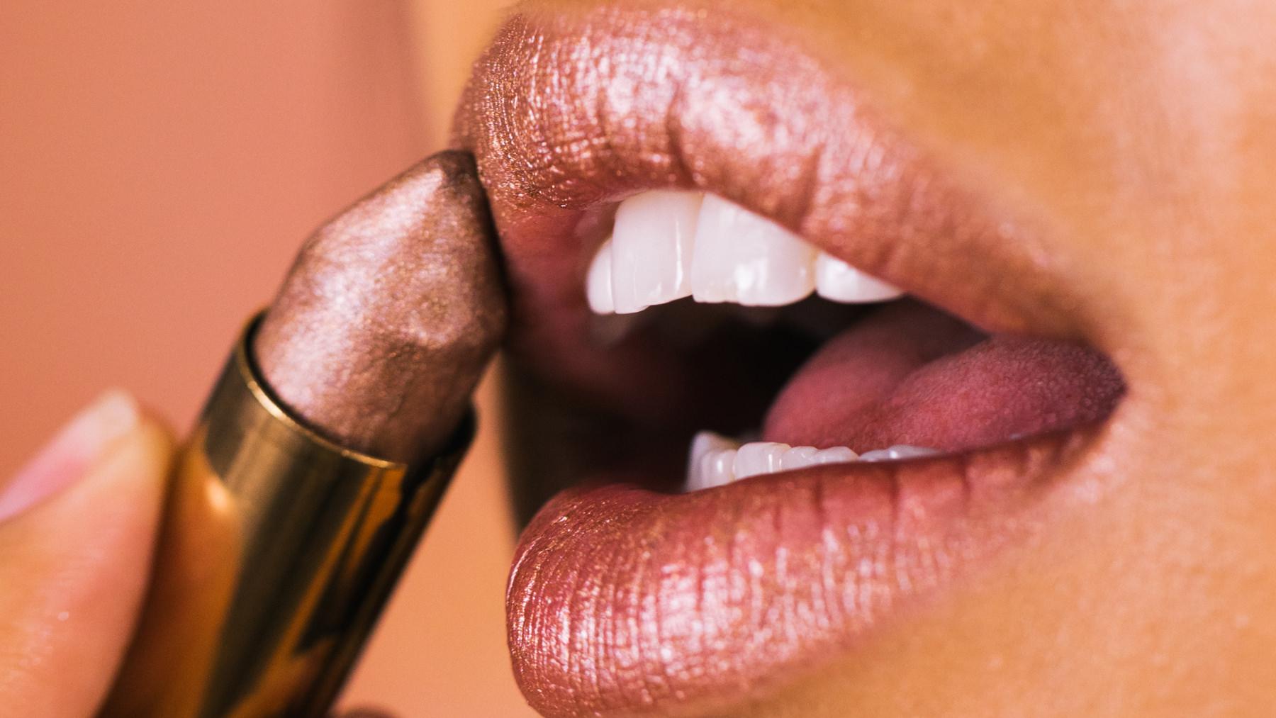 a pair of lips applying lipstick