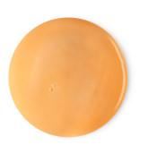 orange circular dollop of body milk