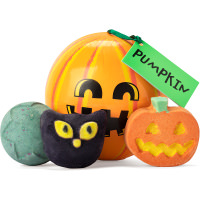 a pumpkin shaped gift with an array of halloween products